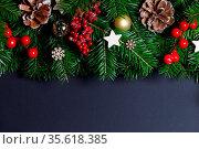 Natural fir Christmas tree border frame with decor on black, copy... Стоковое фото, фотограф Zoonar.com/Ivan Mikhaylov / easy Fotostock / Фотобанк Лори