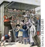 New Year's Day in Paris: Street market stall holder demonstrates ... Редакционное фото, агентство World History Archive / Фотобанк Лори