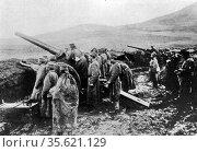 A Serbian heavy artillery battery, men standing in wet, muddy fortification... Редакционное фото, агентство World History Archive / Фотобанк Лори