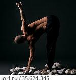 Man doing yoga in studio. Стоковое фото, фотограф Гурьянов Андрей / Фотобанк Лори