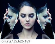 Young female with eyes closed and mirror shard in hands. Стоковое фото, фотограф Serg Zastavkin / Фотобанк Лори