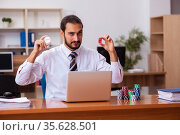 Young male employee in gambling concept. Стоковое фото, фотограф Elnur / Фотобанк Лори