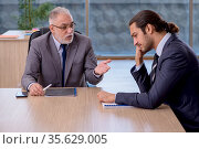 Two businessmen discussing business project. Стоковое фото, фотограф Elnur / Фотобанк Лори