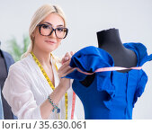 Woman tailor working on new dress designs. Стоковое фото, фотограф Elnur / Фотобанк Лори