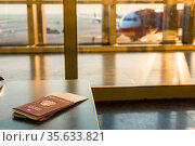 Airline tickets and documents on a background of an airplane. Стоковое фото, фотограф Константин Лабунский / Фотобанк Лори
