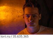 Portrait of attractive young man in neon lighting. Стоковое фото, фотограф Женя Канашкин / Фотобанк Лори