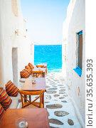 Typical Greek bar in Mykonos town with sea view, Cyclades islands, Greece. Стоковое фото, фотограф Дмитрий Травников / Фотобанк Лори