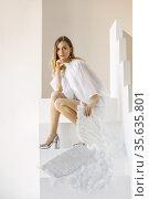 Beautiful young caucasian woman with angel wings poses in the studio. Стоковое фото, фотограф Алексей Кузнецов / Фотобанк Лори