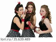 Three beautiful retro girls. Group of women with retro telephone. ... Стоковое фото, фотограф Zoonar.com/Lazarenka Sviatlana / age Fotostock / Фотобанк Лори