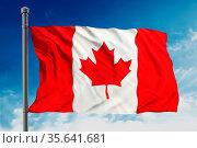 Flag of Canada on blue sky. Стоковое фото, фотограф Zoonar.com/Cigdem Simsek / easy Fotostock / Фотобанк Лори