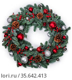 Christmas green fir tree wreath and decoration isolated on white background... Стоковое фото, фотограф Zoonar.com/Ivan Mikhaylov / easy Fotostock / Фотобанк Лори