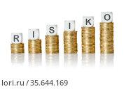 Coin stacks with letter dice - Risk - Risiko German. Стоковое фото, фотограф Zoonar.com/Boris Zerwann / easy Fotostock / Фотобанк Лори