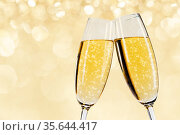Two glasses of champagne with bokeh lights in the background New Year... Стоковое фото, фотограф Zoonar.com/Ivan Mikhaylov / easy Fotostock / Фотобанк Лори