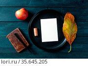 Autumn stationery mockup, a vertical A5 greeting card or invitation... Стоковое фото, фотограф Zoonar.com/Katerina Solovyeva / easy Fotostock / Фотобанк Лори