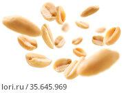 Peeled peanuts levitate on a white background. Стоковое фото, фотограф Zoonar.com/Aleksey Butenkov / easy Fotostock / Фотобанк Лори