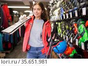 Portrait of woman standing in skiing gear during shopping in sport equipments shop. Стоковое фото, фотограф Яков Филимонов / Фотобанк Лори