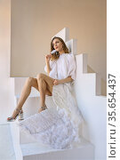 Pretty woman with angel wings poses in the studio. Стоковое фото, фотограф Алексей Кузнецов / Фотобанк Лори