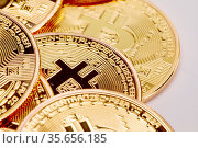 Many gold color coins with bitcoin sign close up. Стоковое фото, фотограф Zoonar.com/Ivan Mikhaylov / easy Fotostock / Фотобанк Лори