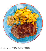 Grilled beef tenderloin steak and fried potato with sauce. Стоковое фото, фотограф Яков Филимонов / Фотобанк Лори