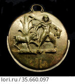 Bronze folding mirror with a depiction of Paniskos holding a situla... Редакционное фото, агентство World History Archive / Фотобанк Лори
