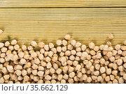 Uncooked chickpea on wooden surface. Стоковое фото, фотограф Яков Филимонов / Фотобанк Лори