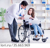 Disabled patient on wheelchair visiting doctor for regular check. Стоковое фото, фотограф Elnur / Фотобанк Лори