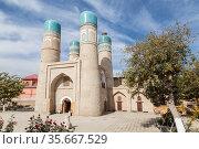 Chor-Minor Madrasah, Theological educational institution (1807) in Bukhara on a sunny day, Uzbekistan (2019 год). Стоковое фото, фотограф Наталья Волкова / Фотобанк Лори