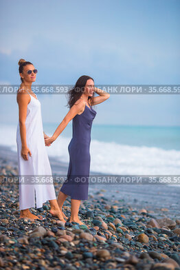 Young women in white on the beach