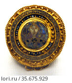 The Castellani brooch. This gold disc brooch is decorated in cloisonné... Редакционное фото, агентство World History Archive / Фотобанк Лори