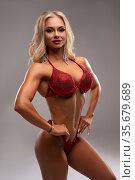 Powerful blond female model in glittering bikini. Стоковое фото, фотограф Гурьянов Андрей / Фотобанк Лори