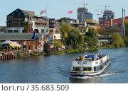 Berlin, Germany - Spreeufer with Holzmarkt 25 and Kater Blau. Редакционное фото, агентство Caro Photoagency / Фотобанк Лори