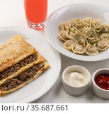 Dinner with dumplings and crepe filled with meat. Стоковое фото, фотограф Гурьянов Андрей / Фотобанк Лори
