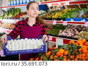 Young cheerful woman salesman carrying box with fresh mushrooms. Стоковое фото, фотограф Яков Филимонов / Фотобанк Лори