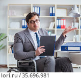 Disabled businessman working in the office. Стоковое фото, фотограф Elnur / Фотобанк Лори