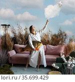 Fantasy concept with a beautiful girl holding a cloud lamb and a fish. Стоковое фото, фотограф Алексей Кузнецов / Фотобанк Лори