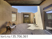 Courtyard with adobe walls and brick paving with wooden doors in ... Редакционное фото, фотограф Larry Malvin / age Fotostock / Фотобанк Лори