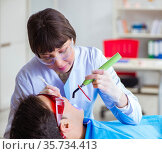 Woman dentist doctor with male patient in hospital. Стоковое фото, фотограф Elnur / Фотобанк Лори