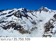 The Sattelhorn (left) and Aletschhorn (right) above the Aletsch glacier... Стоковое фото, фотограф Neil Harrison / age Fotostock / Фотобанк Лори