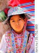 Girl in traditional dress sitting at the market in Maca village in... Стоковое фото, фотограф Zoonar.com/Don Mammoser / age Fotostock / Фотобанк Лори