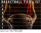 Composition of basketball tier list text and tier grid over player holding ball on black. Стоковое фото, агентство Wavebreak Media / Фотобанк Лори