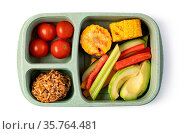 Lunch box with delicious food isolated on a white background. Стоковое фото, фотограф Zoonar.com/Serghei Platonov / easy Fotostock / Фотобанк Лори