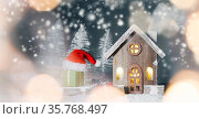 Christmas card with small glowing decorative house , gifts and Santa... Стоковое фото, фотограф Zoonar.com/Ivan Mikhaylov / easy Fotostock / Фотобанк Лори