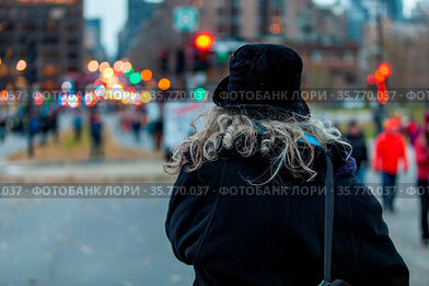 Old woman is looking at the crowd during an ecological protest. Shot...