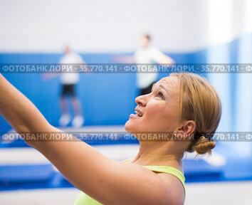 Woman training in trampoline center