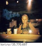 Girl is drinking coffee, vintage holga image. Стоковое фото, фотограф Данил Руденко / Фотобанк Лори