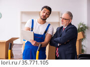 Old businessman and young contractor in relocation concept. Стоковое фото, фотограф Elnur / Фотобанк Лори