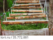 Wooden stairs in the green forest park with ropes. Стоковое фото, фотограф Zoonar.com/Maxim Pavlov / age Fotostock / Фотобанк Лори