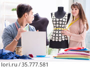 Male tailor with female student in workshop. Стоковое фото, фотограф Elnur / Фотобанк Лори