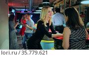 Young women drink cocktails at the bar in nightclub. Стоковое видео, видеограф Яков Филимонов / Фотобанк Лори