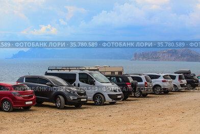 Cars on the sandy seashore